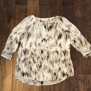 Black, gray, and white patterned shirt